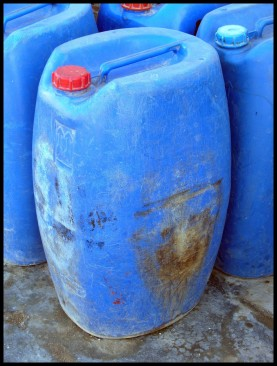 The blue jerry cans often used to transport and store well water.